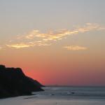 Suggestive nuvole illuminate dal sole ormai dietro il San Bartolo.