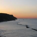 Luce del tramonto e grattacieli romagnoli visti da Baia Flaminia
